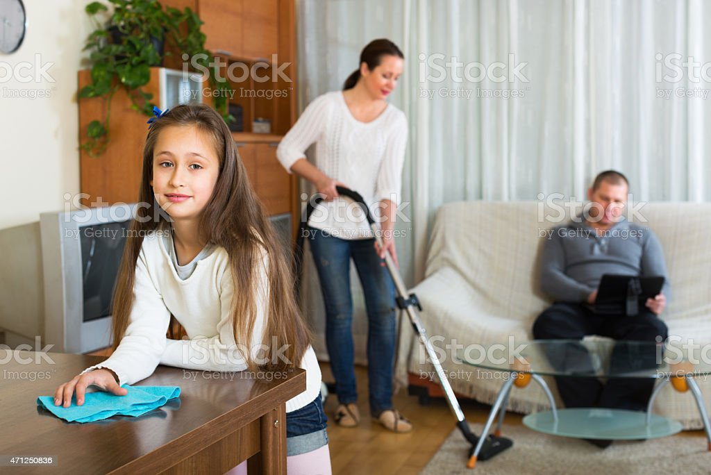 Woman and girl doing cleaning stock photo