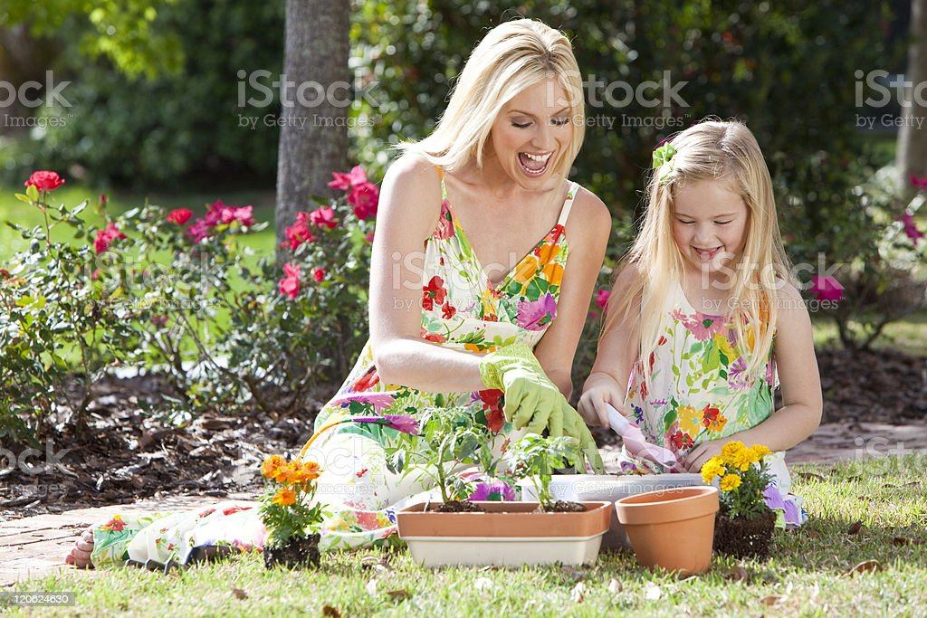 Woman and Girl, Mother & Daughter, Gardening Planting Flowers royalty-free stock photo