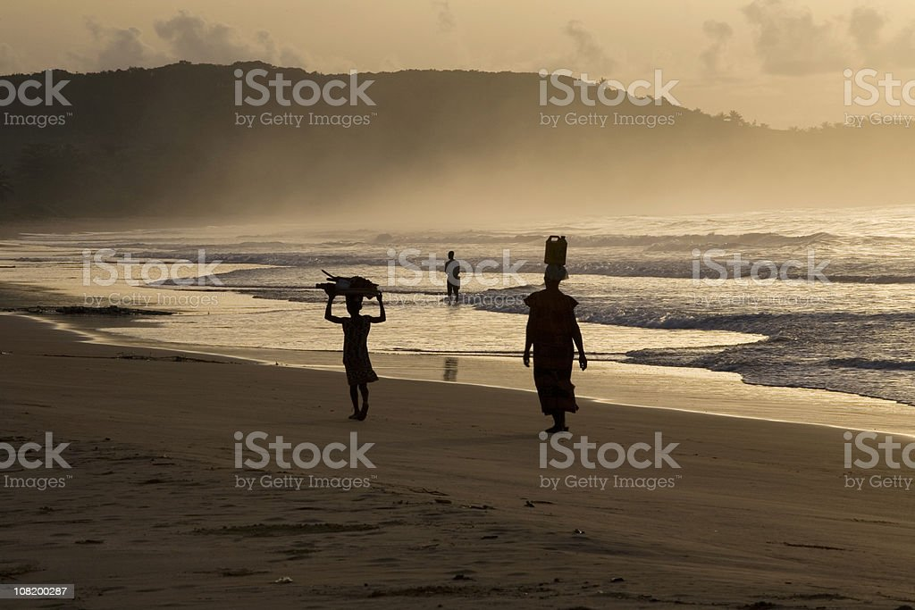 Woman and Girl on Busua Beach stock photo