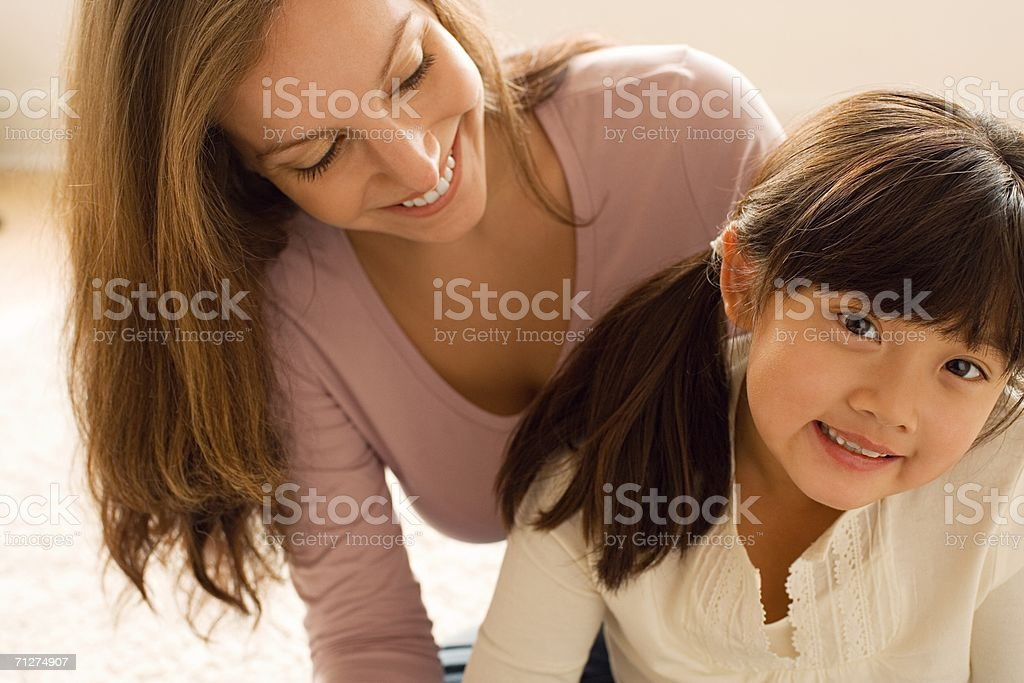 Woman and girl sitting in lounge room royalty-free stock photo