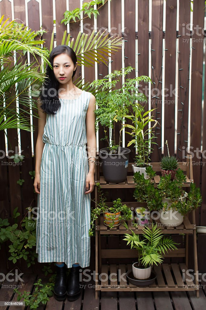 woman and green plants stock photo