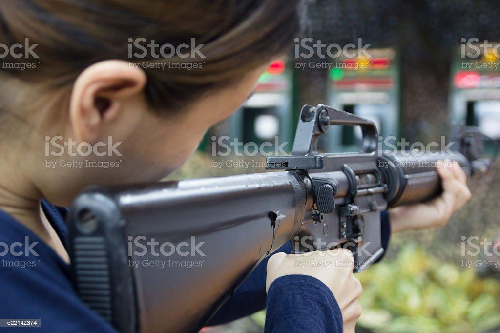 woman and gun fire stock photo