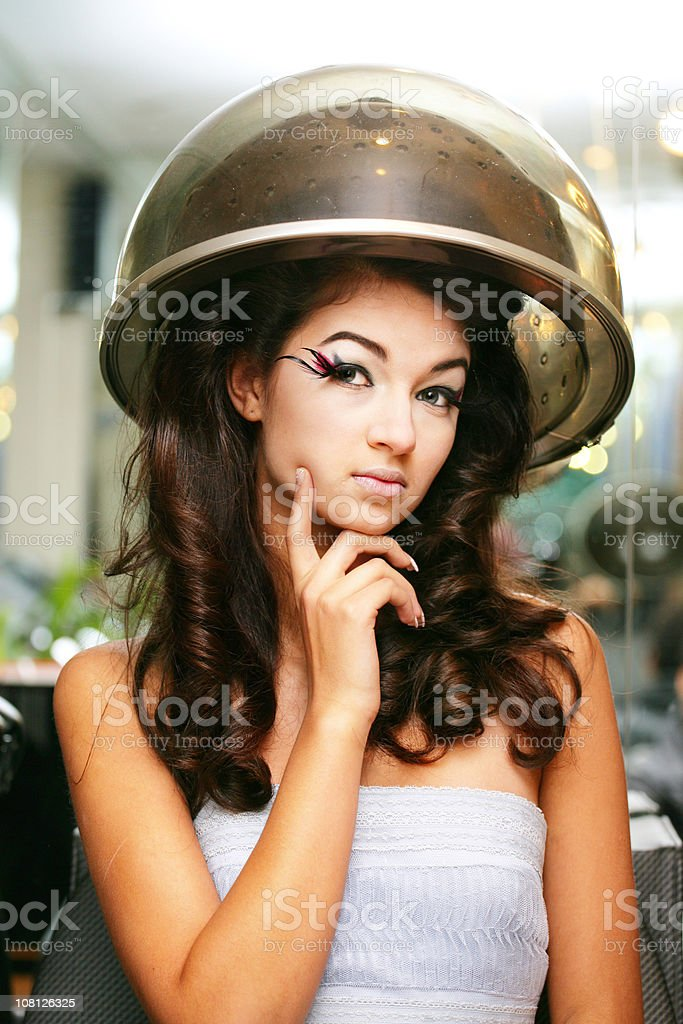 Woman and hair dryer royalty-free stock photo