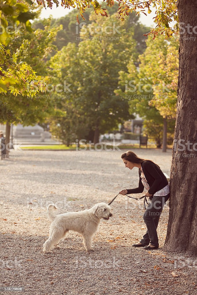 Woman and her dog in a park royalty-free stock photo