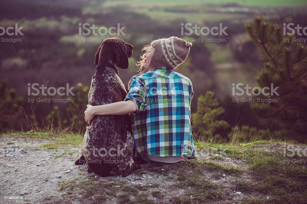 Woman and her dog posing outdoor. stock photo