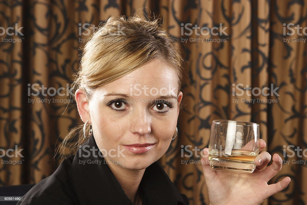 Woman and her drink royalty-free stock photo