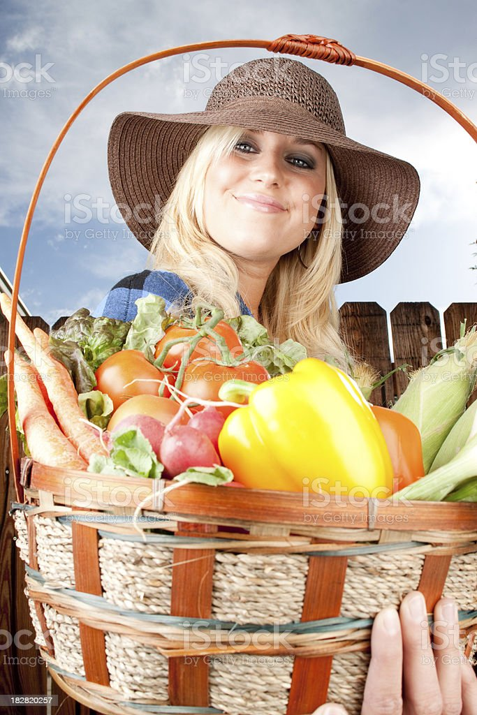 Woman and her fresh garden vegtables royalty-free stock photo