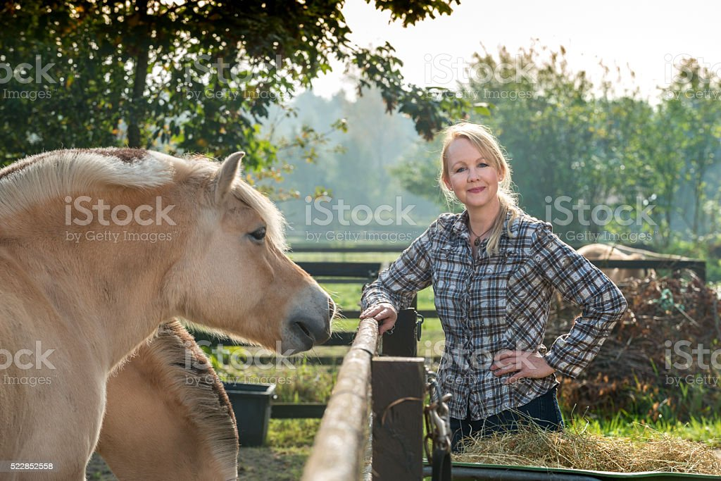 Woman and her horse stock photo
