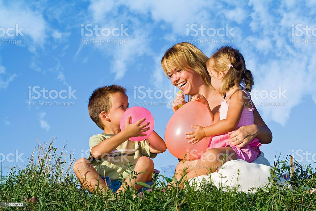 Woman and her kids playing royalty-free stock photo