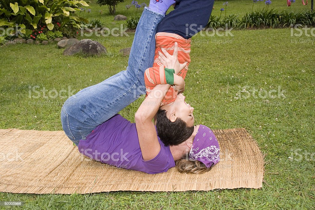 Woman and her son swinging royalty-free stock photo