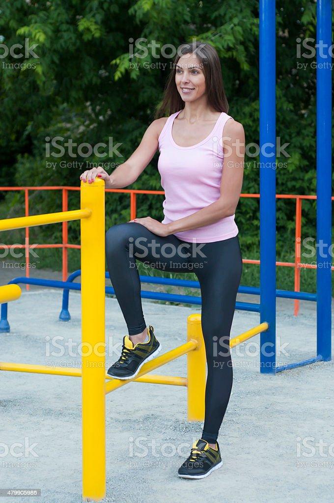 Woman and horizontal bar stock photo