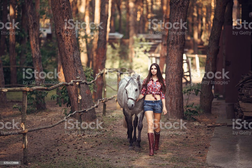 Woman and Horse. Casual Sexy Style stock photo