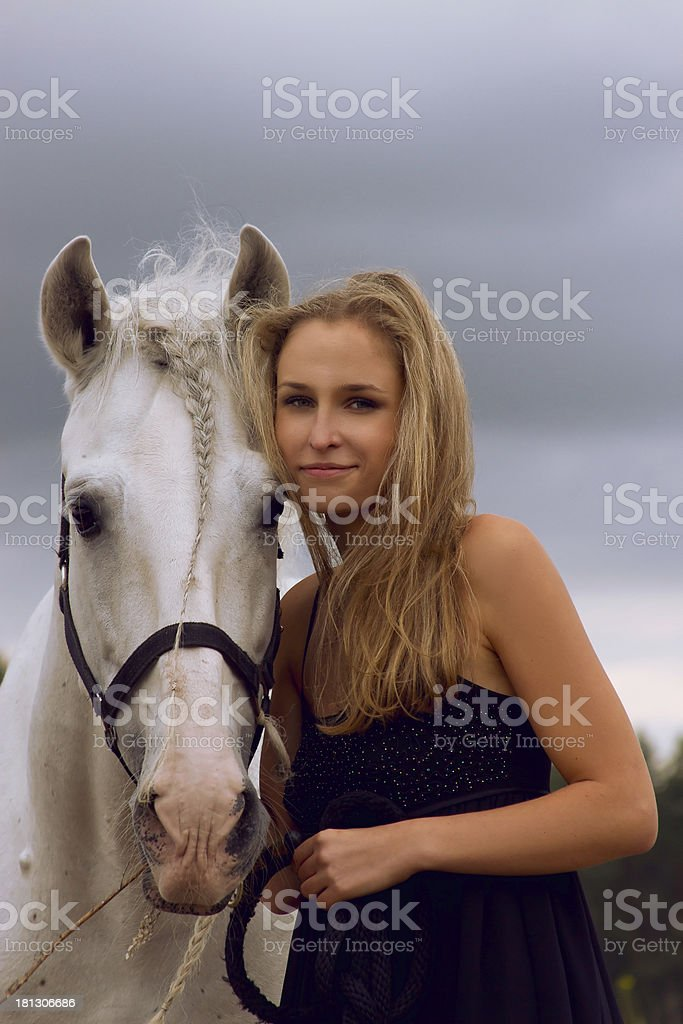 Woman and horse royalty-free stock photo