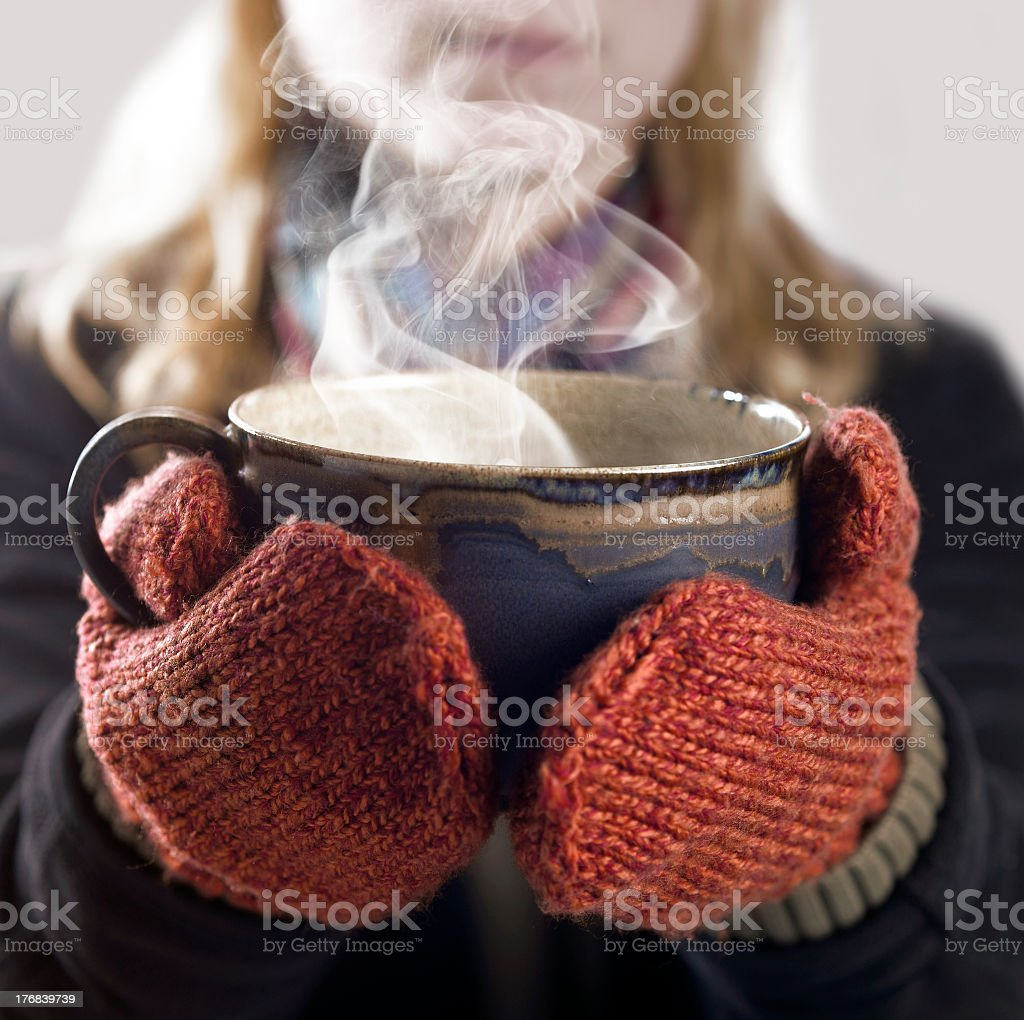 woman and hot steaming cup royalty-free stock photo