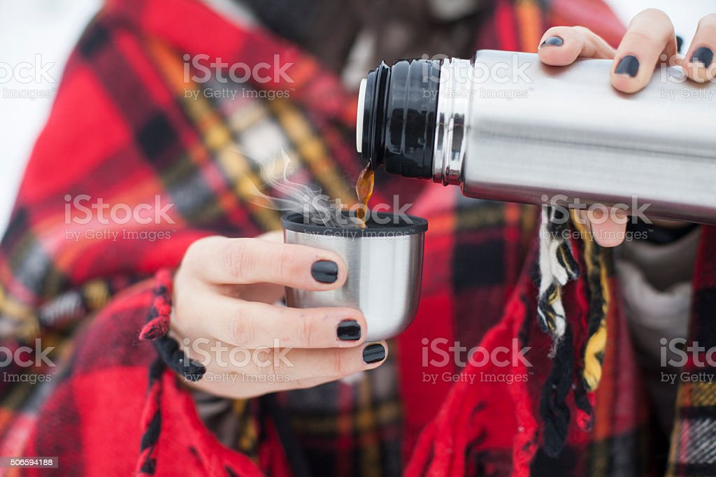 woman and hot steaming cup stock photo