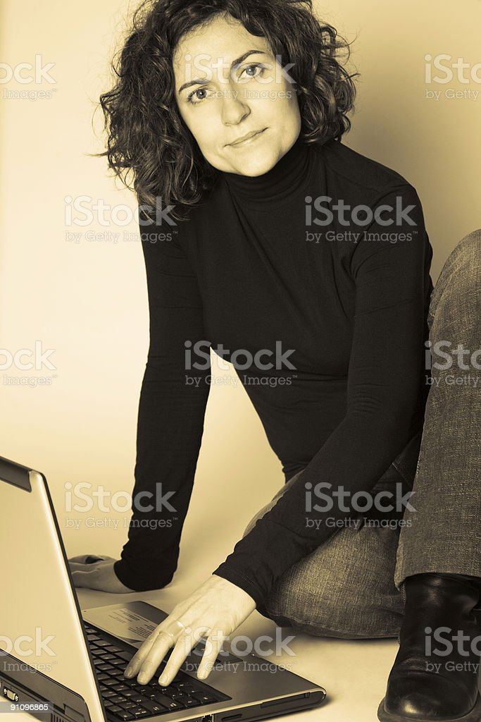 Woman and laptop in sepia royalty-free stock photo