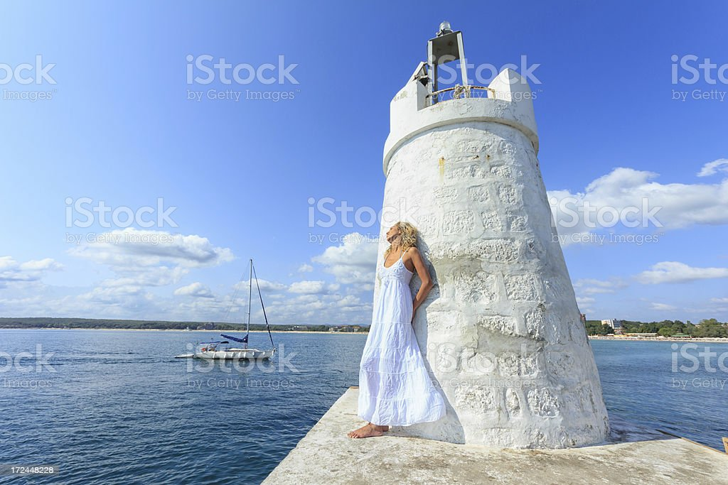 Woman and lighthouse royalty-free stock photo