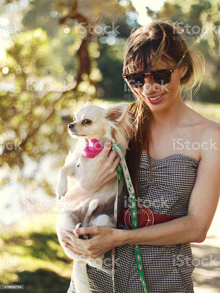 woman and little chihuahua in nature stock photo