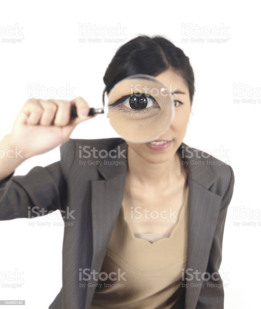 woman and magnifying stock photo
