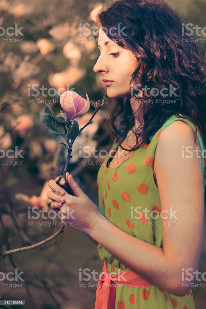 Woman and magnolia royalty-free stock photo