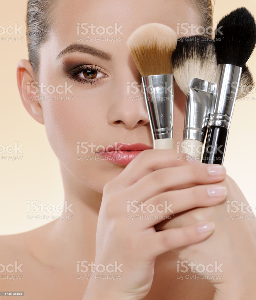 woman and makeup brushes royalty-free stock photo