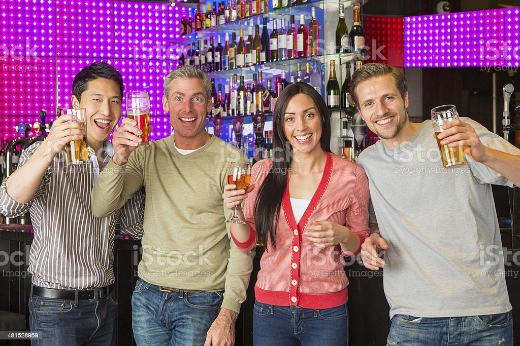 Woman and Male Friends in a Bar royalty-free stock photo