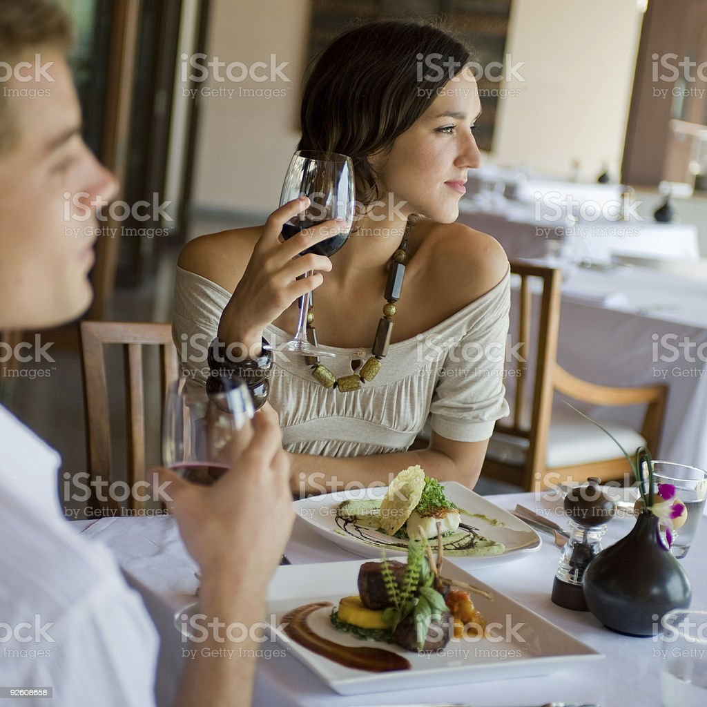 Woman and man at beautiful ethnic dinner overlooking a view stock photo