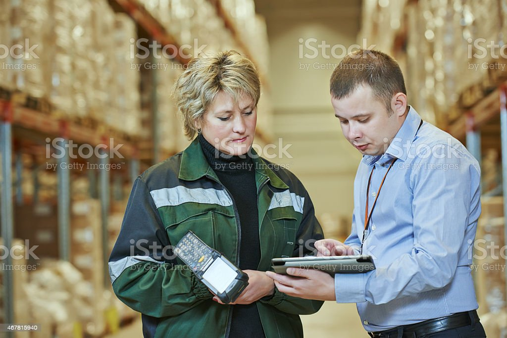 Woman and man at work on a warehouse stock photo