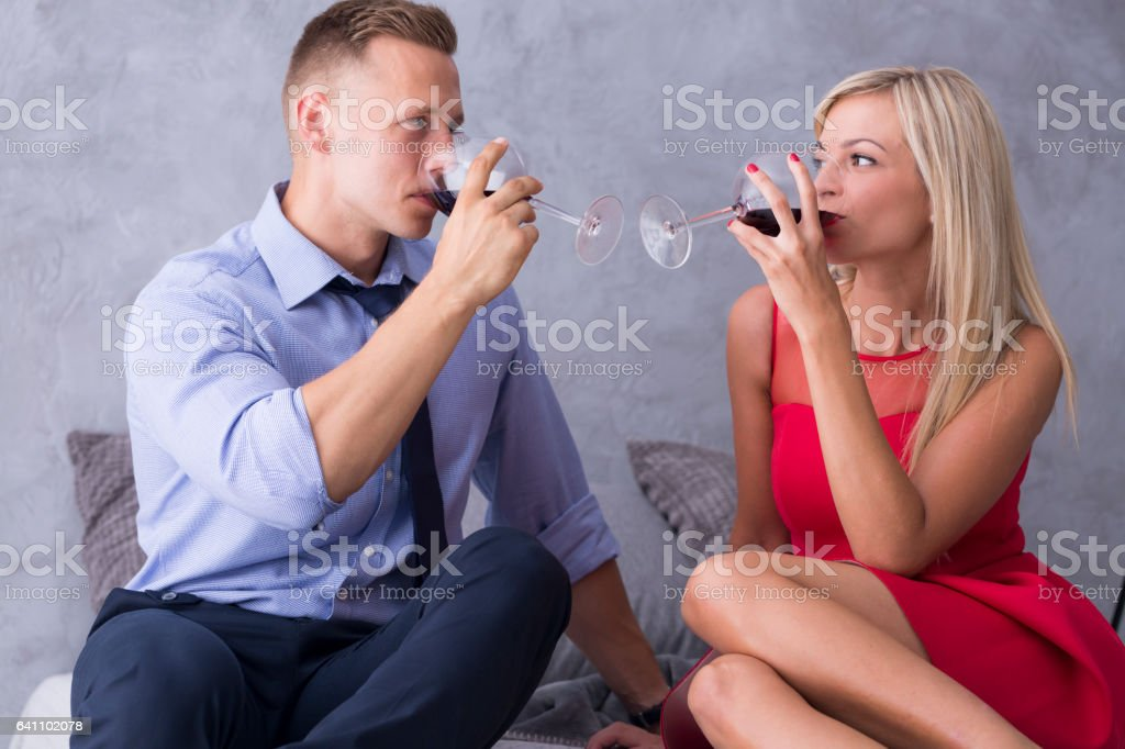 Woman and man drinking wine stock photo