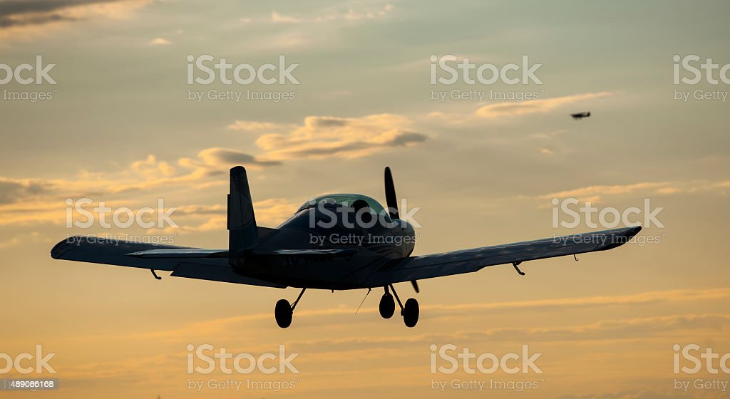 Woman and man flying at sunset stock photo