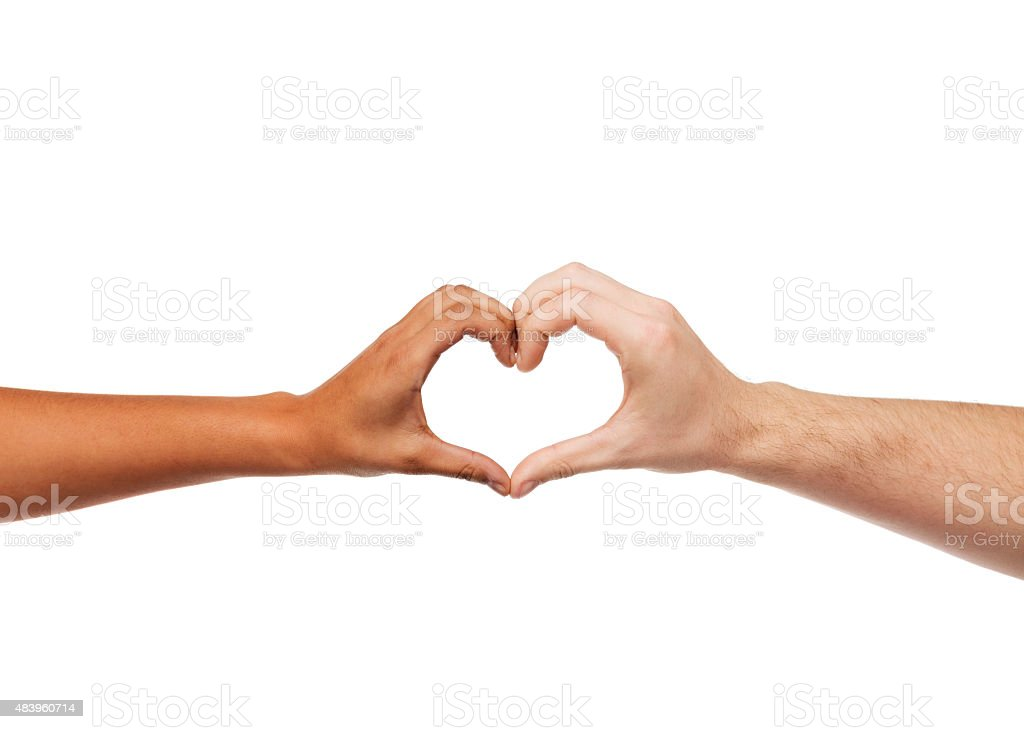 woman and man hands showing heart shape stock photo