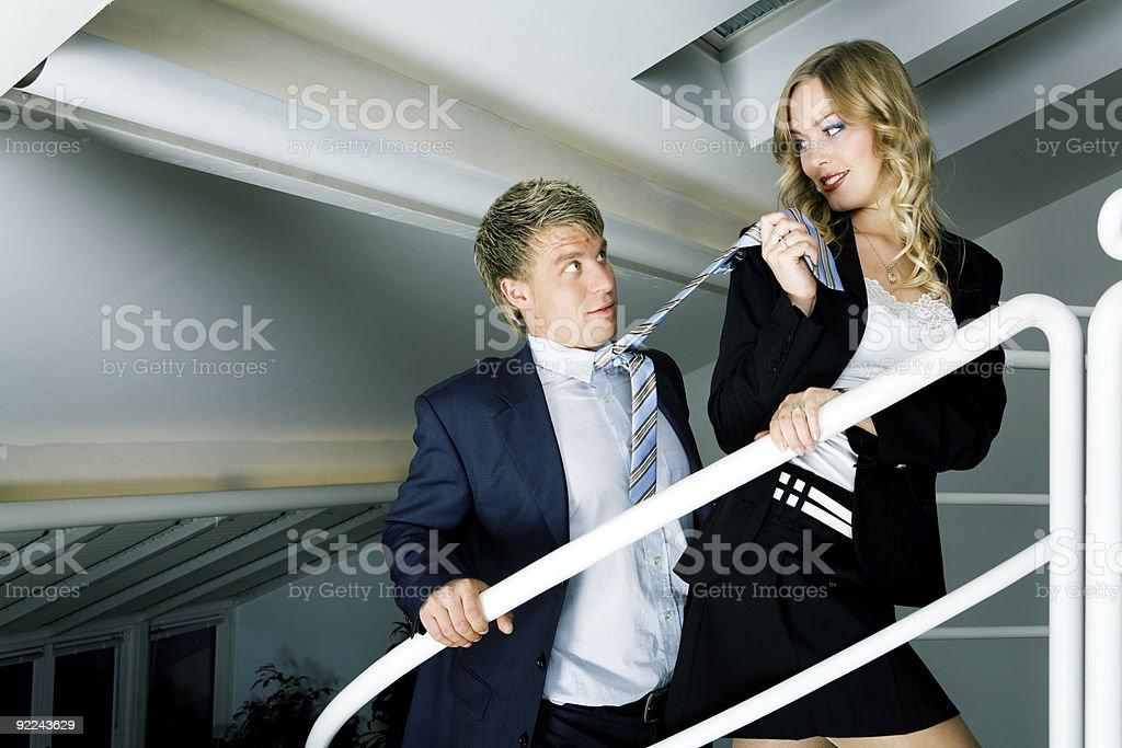 Woman and man having an office affair royalty-free stock photo