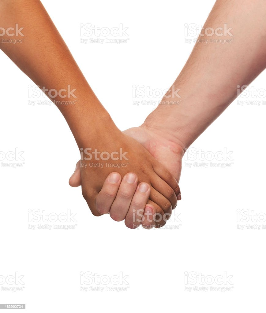 woman and man holding hands stock photo