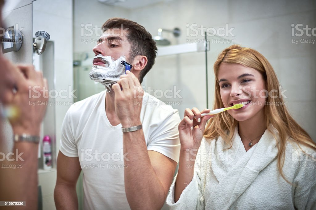 Woman and man in bathroom stock photo