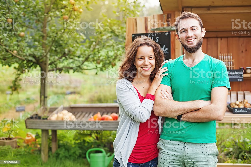 Woman and man in the garden stock photo