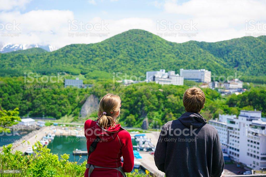 Woman and man looking at Shiretoko coast at Utoro, Hokkaido stock photo