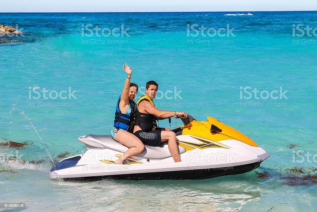 Woman and man on a jet ski stock photo