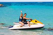 Woman and man on a jet ski