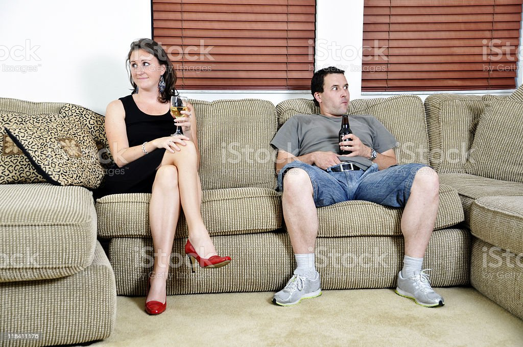 Woman and Man Opposites Sitting on a Couch Not Speaking stock photo