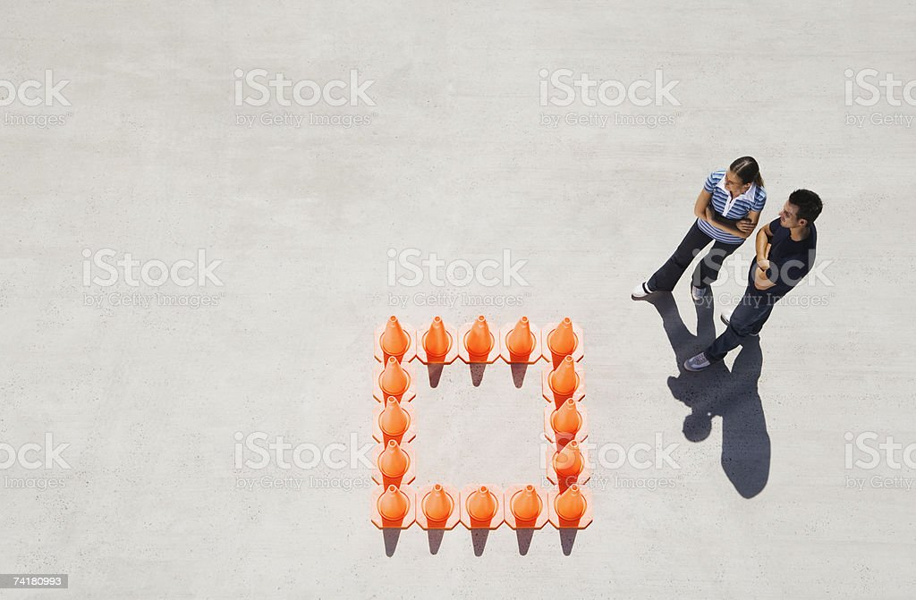 Woman and man outside box of traffic cones royalty-free stock photo