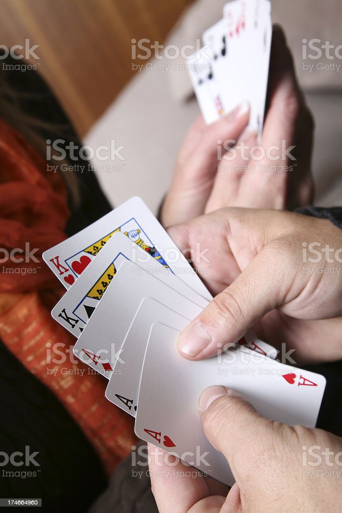 Woman And Man Playing Cards royalty-free stock photo