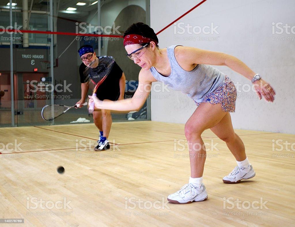 Woman and man playing squash stock photo