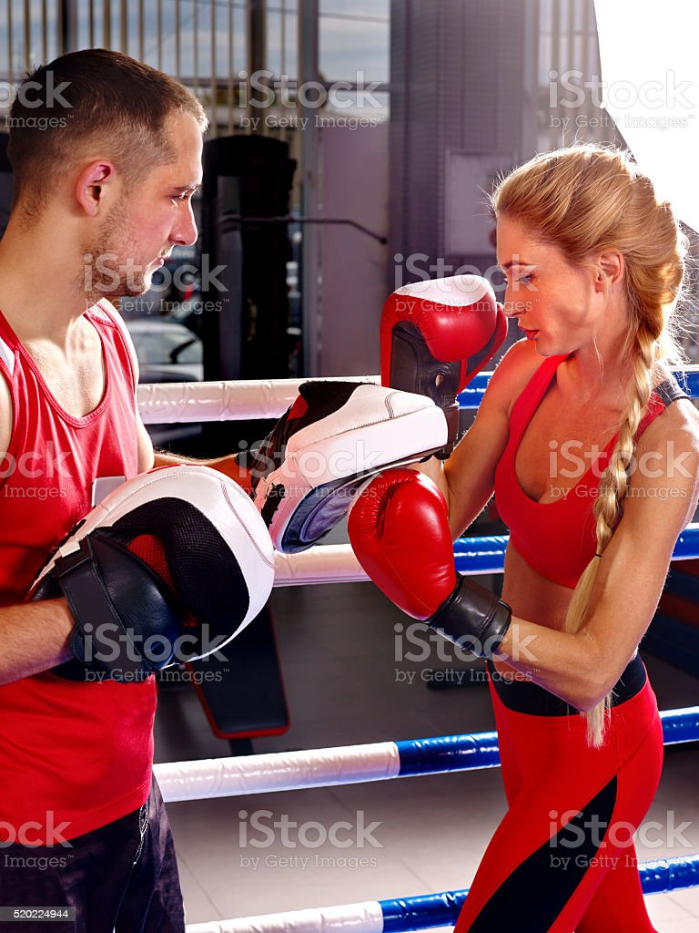 Woman and man train in boxing style stock photo
