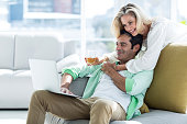 Woman and man using at home