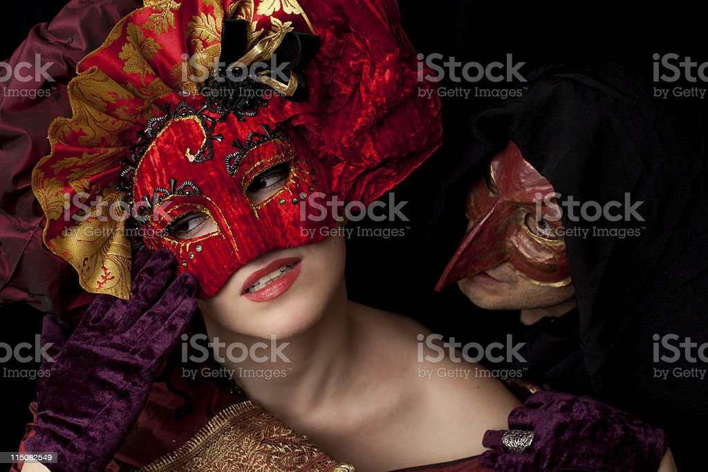 Woman and man wearing carnival masks stock photo