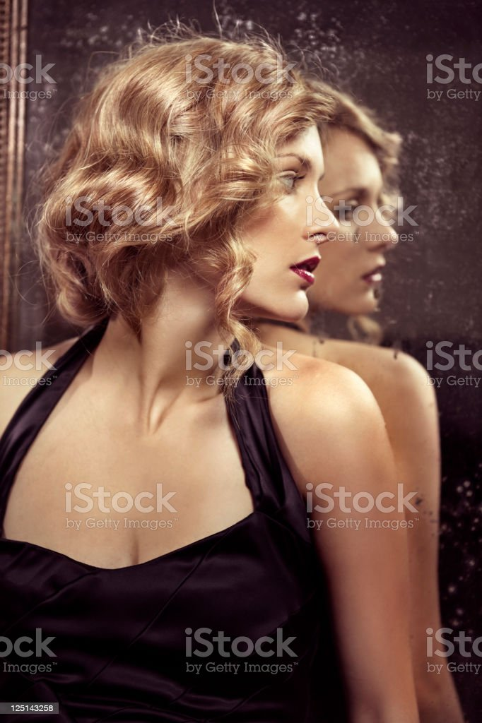 Woman and mirror stock photo