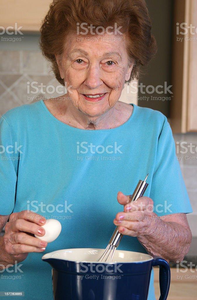 Woman and mixing bowl royalty-free stock photo