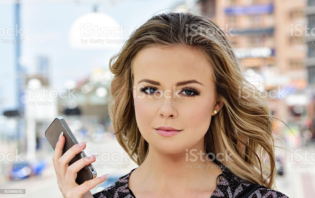 Woman and mobile phone in Stockholm city stock photo