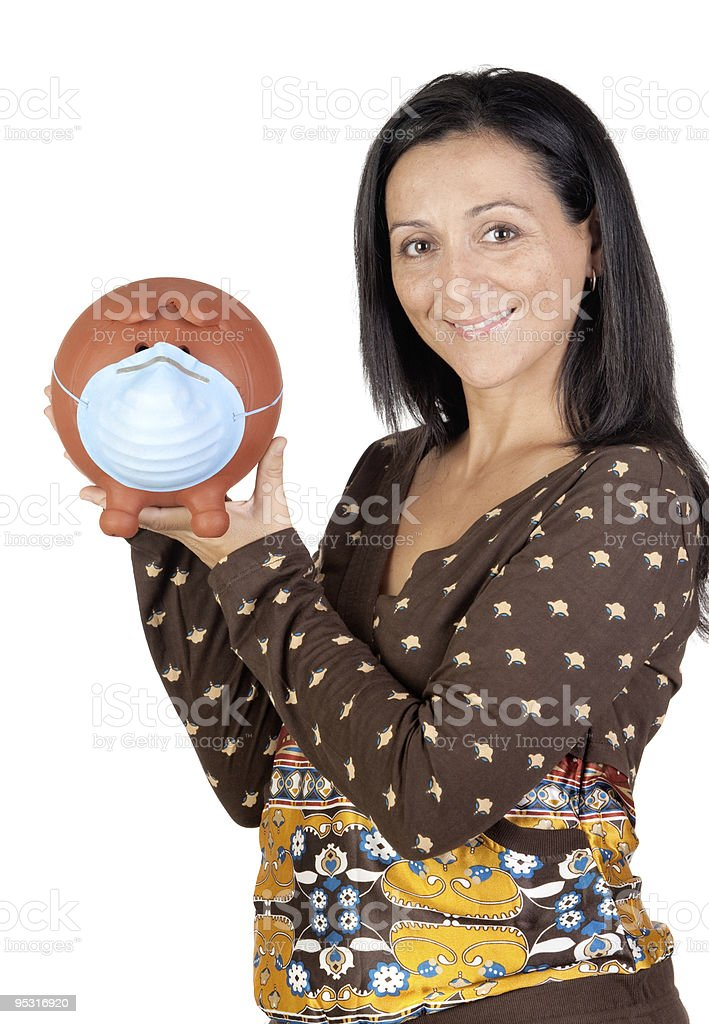 Woman and moneybox with mask stock photo