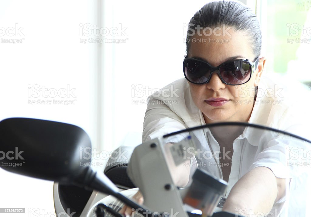 Woman and motorcycle royalty-free stock photo